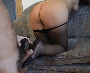 Amateurs occupied with a pantyhosed footjob