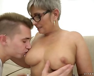 Grandma deepthroats a juvenile heavy dick before riding at bottom it