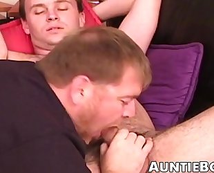 Bearded mature guy deepthroats hard young cock like a pro