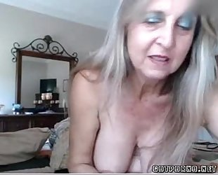 Hot breasty aged playgirl inserts anal plug and rubs vagina