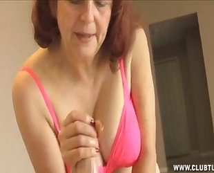Mature woman jerking a rod