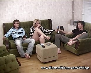 Blonde older double teamed by youthful guys