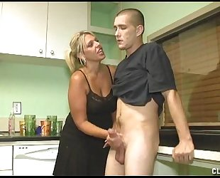Dominant milf tugjob in the kitchen