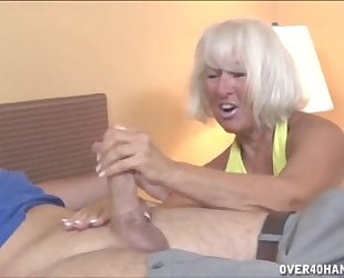 Granny jerking the juvenile dude