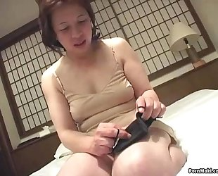 Asian granny inserts a sex toy in her bawdy cleft